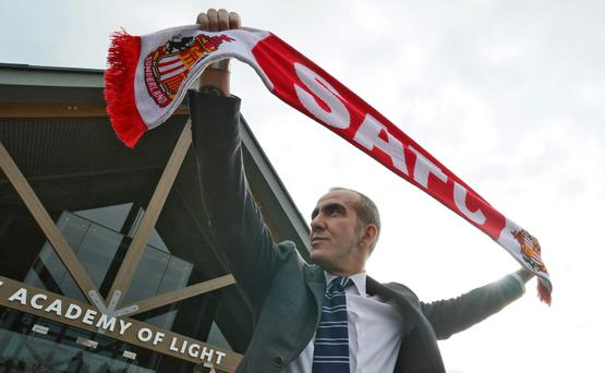 Sunderland's new coach Paolo Di Canio poses for photographs during a media conference at the football club's training academy in Sunderland, northern England April 2, 2013.