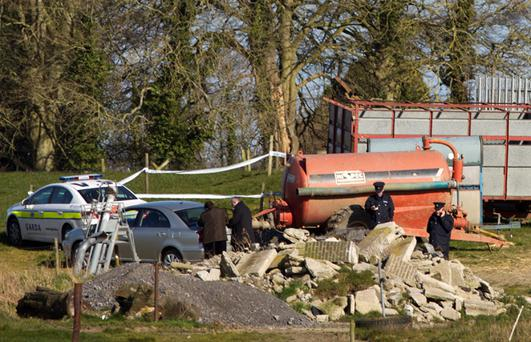 Gardai at the scene in Balheary, Swords, where a body was found in a field