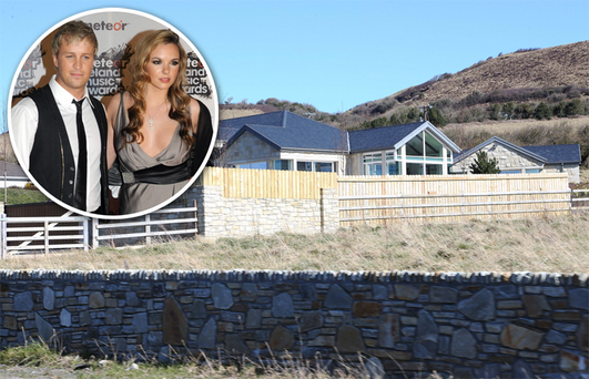 Kian Egan and wife Jodi have been ordered to take down the fence around their home