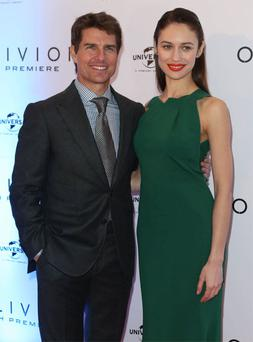 Tom Cruise and Olga Kurylenko on the red carpet for the premiere of Oblivion, at the Savoy Theatre, Dublin