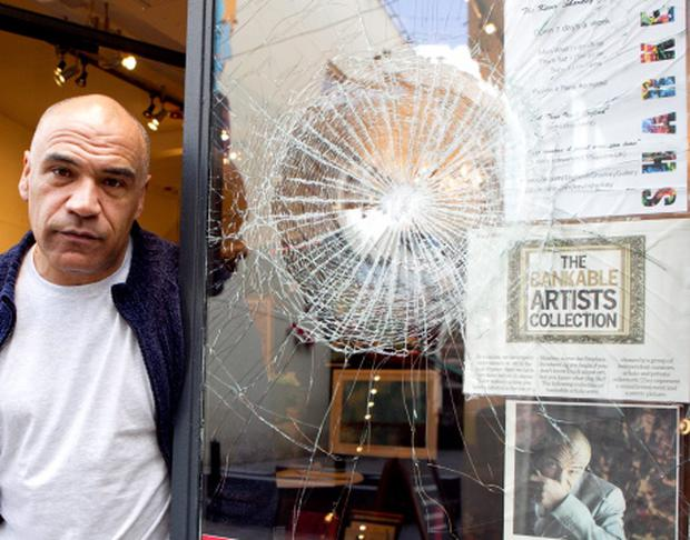 Kevin Sharkey pictured at the smashed window of his Gallery in Temple Bar