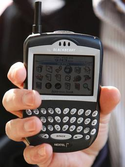 The Blackberry revolutionised business on the go, with the phone's round-the-clock email access and QWERTY keyboard. Pictured is one of their first colour models, the Blackberry 7520. Photo: Reuters