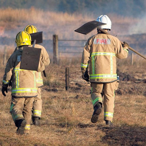 Fire service personnel near Connolly, Co Clare, where fires destroyed large tracts of land.