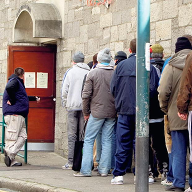 THE TIMES WE LIVE IN: People queuing for food parcels at the Capuchin Day Centre, including many who are classed as the 'new poor'.