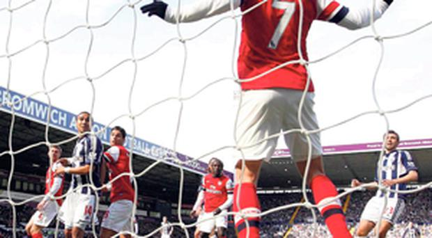 Arsenal's Tomas Rosicky clears the ball from the line during his side's Premier League game against West Bromwich Albion at The Hawthorns
