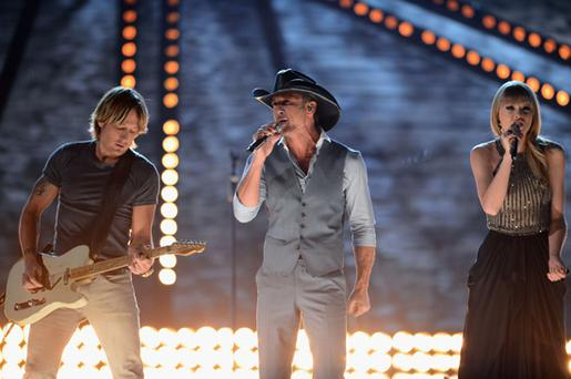 Taylor Swift, Tim McGraw, and Keith Urban perform onstage during the 48th Annual Academy of Country Music Awards at the MGM Grand Garden Arena on April 7, 2013 in Las Vegas, Nevada.
