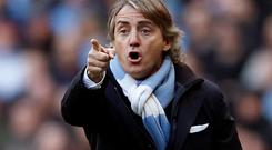 Manchester City manager Roberto Mancini gestures during their match against Manchester United. Picture: Reuters/Eddie Keogh.