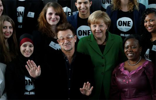 Bono with German Chancellor Angela Merkel and youth representatives of the ONE campaign in Berlin