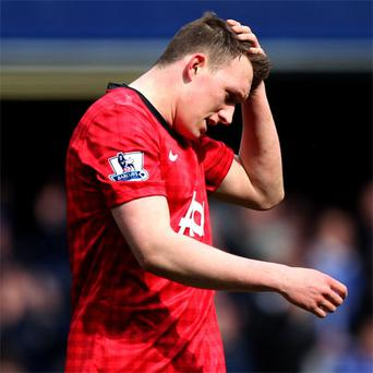 Phil Jones stands dejected after defeat at the hands of Chelsea in the FA Cup quarter final replay at Stamford Bridge