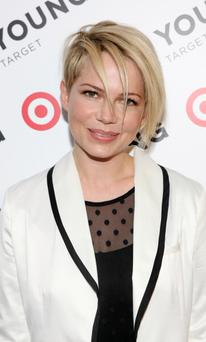Michelle Williams shows off her new edgy haircut in New York last night