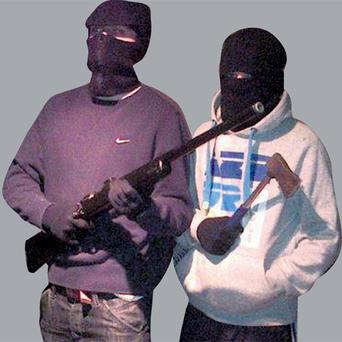 Two members of the gang posing in one of the images uploaded to Facebook