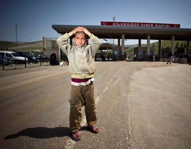 A young Syrian Boy pictured after after cossing the border into Turkey Pic:Mark Condren