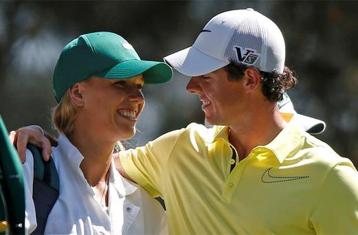 Rory McIlroy of Northern Ireland (R) and his girlfriend, tennis player Caroline Wozniacki of Denmark, stand on the first tee during the annual Masters Par 3 Contest. Photo: Reuters