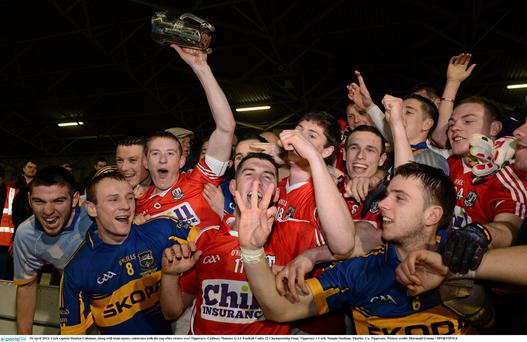Cork captain Damien Cahalane celebrates along with his team-mates