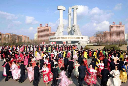 North Koreans dance in front of the Monument to the Foundation of the Workers' Party in Pyongyang as they celebrate the 20th anniversary of late leader Kim Jong-il's election as chairman of North Korea's National Defence Commission