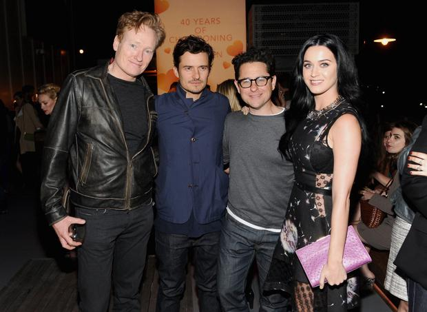 Conan O'Brien, actor Orlando Bloom, host J.J. Abrams and singer Katy Perry attend Coach's 3rd Annual Evening of Cocktails and Shopping to Benefit the Children's Defense Fund hosted by Katie McGrath, J.J. Abrams and Bryan Burk at Bad Robot on April 10, 2013 in Santa Monica, California.