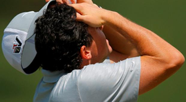 Rory McIlroy feels the heat at the Masters during a second round of 70 which propelled him back into contention.