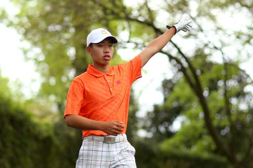 Tianlang Guan of China reacts after a shot on the second hole. Photo: Getty