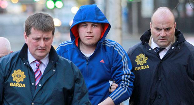Darren Wynne (19), centre, outside Naas District Court in Co Kildare