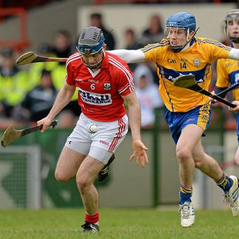 Cork's Christopher Joyce gathers possession under pressure from Clare's Shane O'Donnell