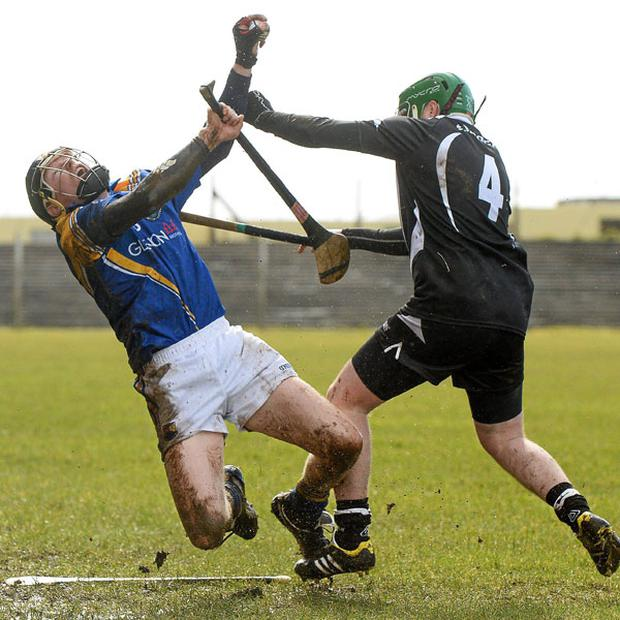Longford's Declan Tanner collides with Sligo's Tomas Cawley