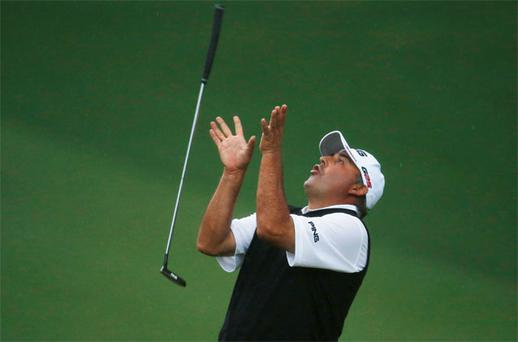 Angel Cabrera of Argentina flips his putter after missing a birdie putt on the second playoff hole