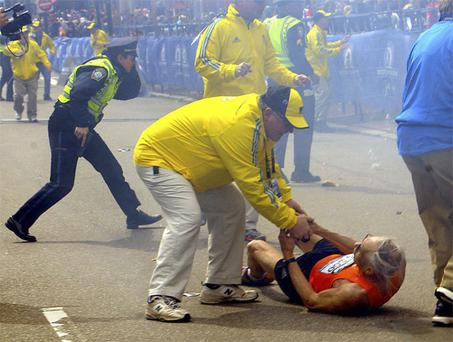 Onlookers rush to help injured in the Boston bombings