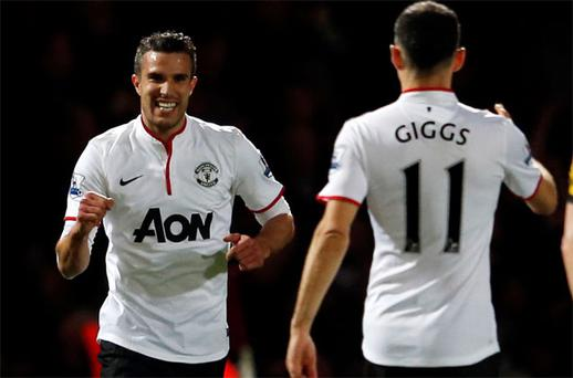 Robin van Persie celebrates with Ryan Giggs after scoring against West Ham