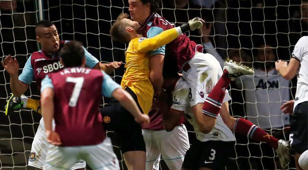 West Ham's Andy Carroll clatters into goalkeeper David De Gea in the incident which enraged Manchester United manager Alex Ferguson