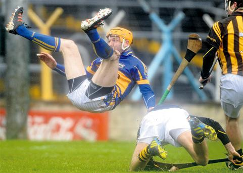 Lar Corbett takes a tumble after scoring the crucial goal in Tipperary's victory over Kilkenny last month