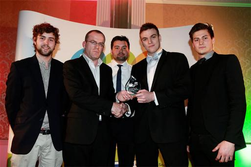 Irish Independent Operations Editor Ian Mallon (second left) presents the prize for publication of the year to Trinity News staff Aaron Devine, George Voronov, Ronan Burtenshaw and Henry Longden