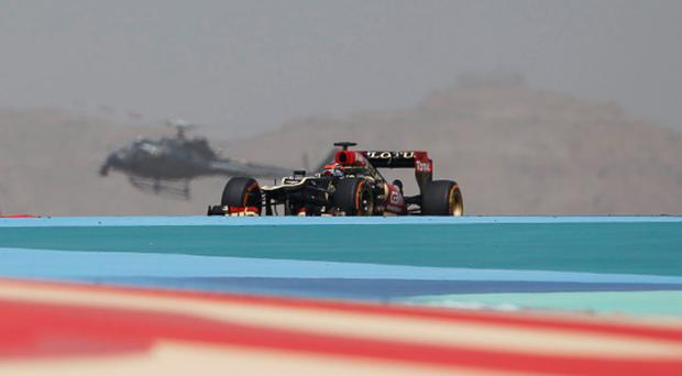 Lotus Formula One driver Kimi Raikkonen of Finland drives during the second practice session of the Bahrain F1 Grand Prix