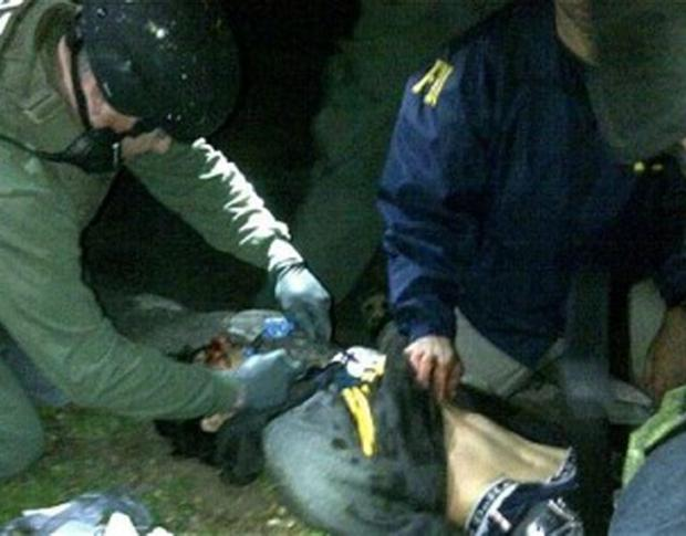 Dzhokhar Tsarnaev being treated by medics shortly after his capture in Watertown.