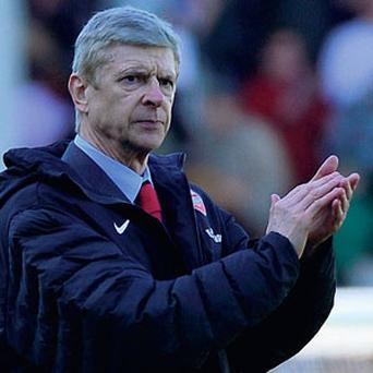 Arsene Wenger applauds his team off the pitch
