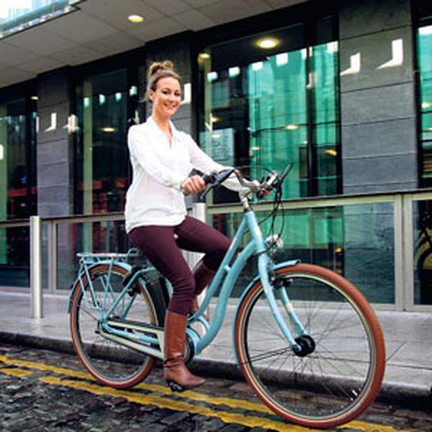 LUCKY BRAKE: Lisa Redden, of successful borrowers GreenAer, rides a Kalkhoff Tasman Classic electric bike.