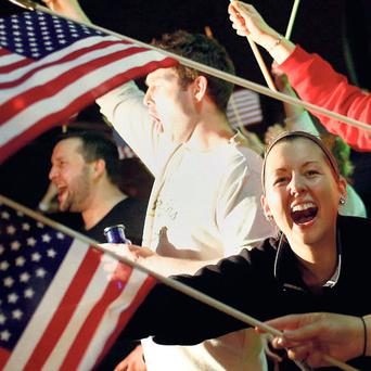 Bostonians cheer the police after the second suspect is captured