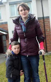 Eilis McSeain, who has multiple sclerosis, with son Darragh (3), who was with her when thieves took her car