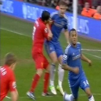 Liverpool's Luis Suarez appears to bite Chelsea's Branislav Ivanovic during the Barclays Premier League match at Anfield