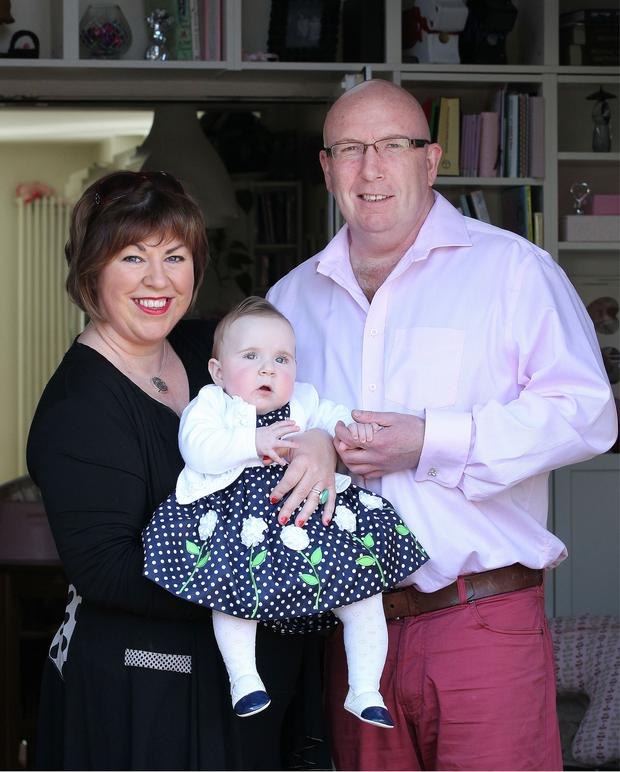 Eight-month-old Clara McLoughlin with her mum Helen and dad Anthony, at their home in Ratoath, Co Meath