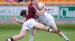 Galway's Seán Moran tries to get past Jonathan Byrne during Saturday's Cadbury All-Ireland U-21 FC semi-final at O'Connor Park, Tullamore
