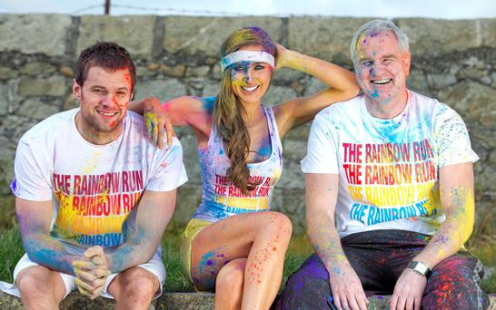 People of all ages and abilities are doused from head to toe with coloured powder paint