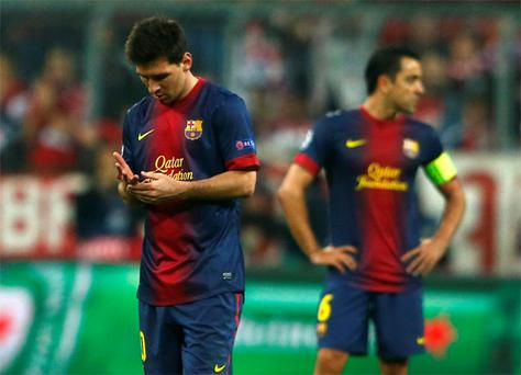 Lionel Messi and Xavi Hernandez cut forlorn figures during Barcelona's mauling by Bayern Munich