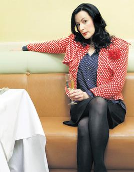 Hannah Betts enjoys a tipple. Photo: Jon Enoch/The Times/NI Syndication.