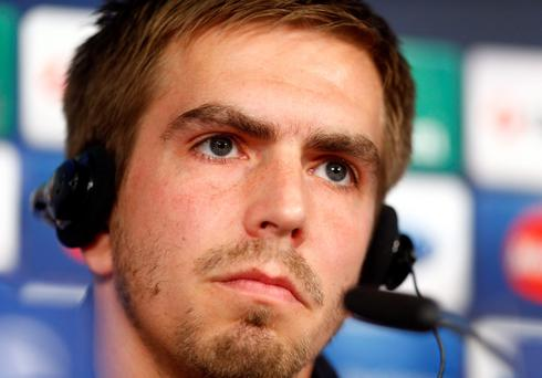 Bayern Munich's Philipp Lahm listens to reporter questions during a news conference