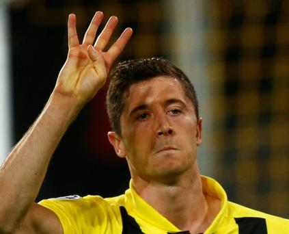 Borussia Dortmund's Robert Lewandowski (C) gestures as he celebrates after scoring a fourth goal against Real Madrid