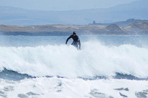 Kian Egan surfs in Donegal