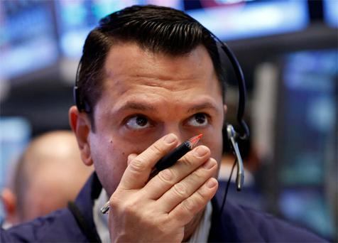 A trader works on the floor at the New York Stock Exchange