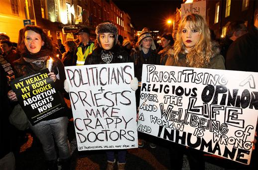 Two women make their point at a protest outside Leinster House.