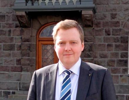 Iceland's Progressive Party chairman Sigmundur Gunnlaugsson stands in front of the Althing, the country's parliament in Reykjavik