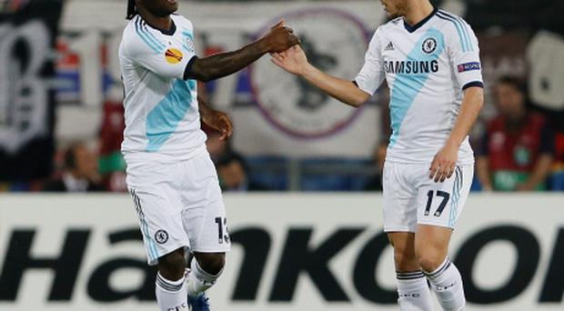 Chelsea's Victor Moses celebrates with Eden Hazard (R) after scoring his goal